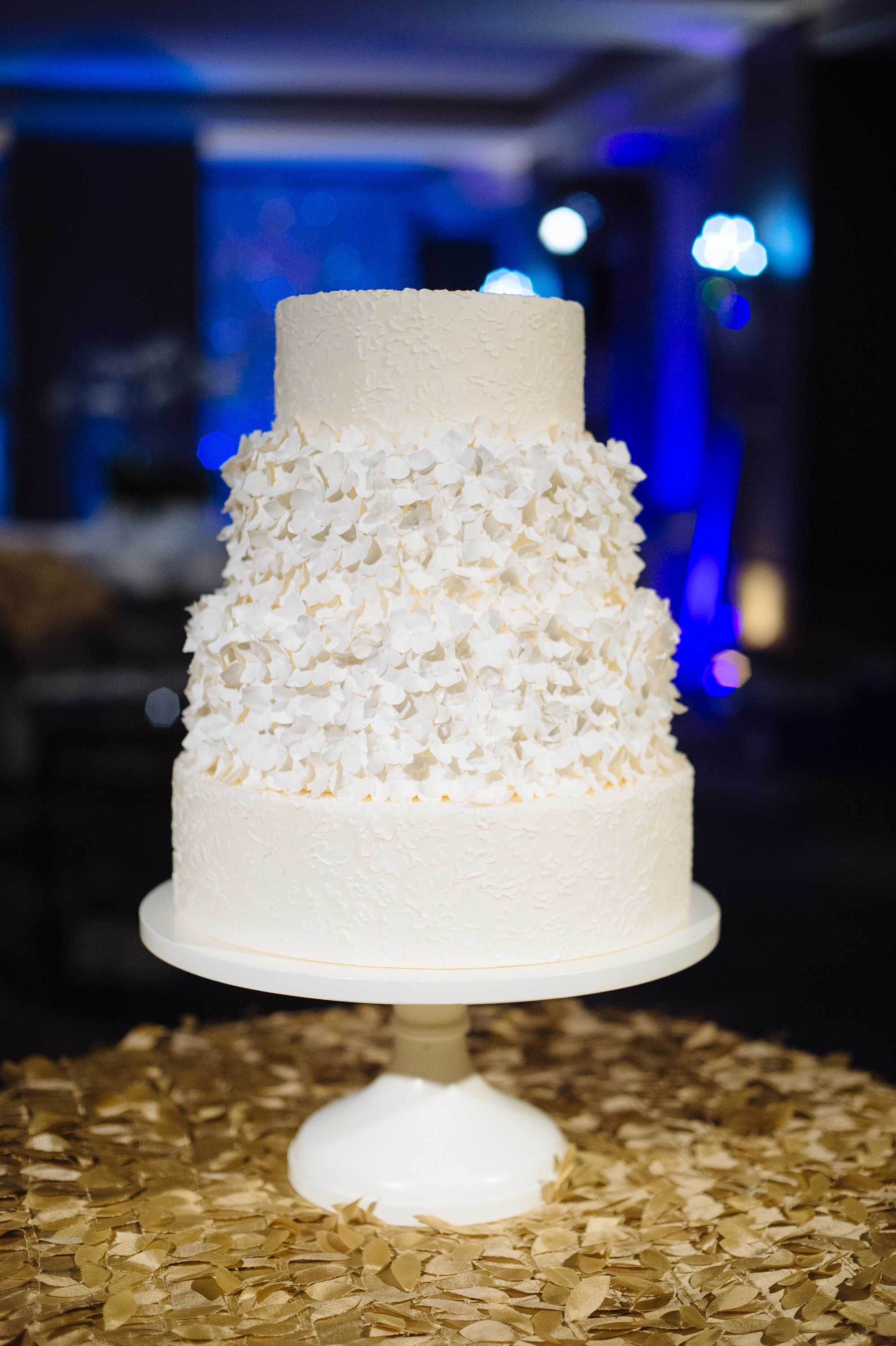 White ruffle wedding cake for winter wedding