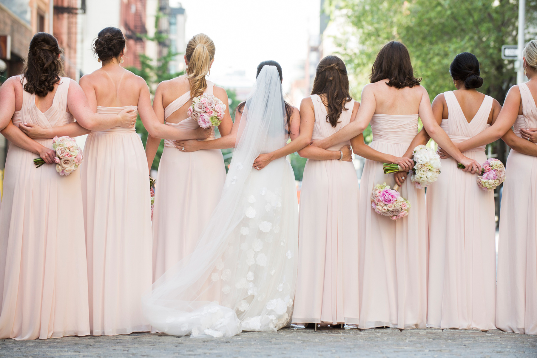 Back of bridesmaids different dresses same color pink