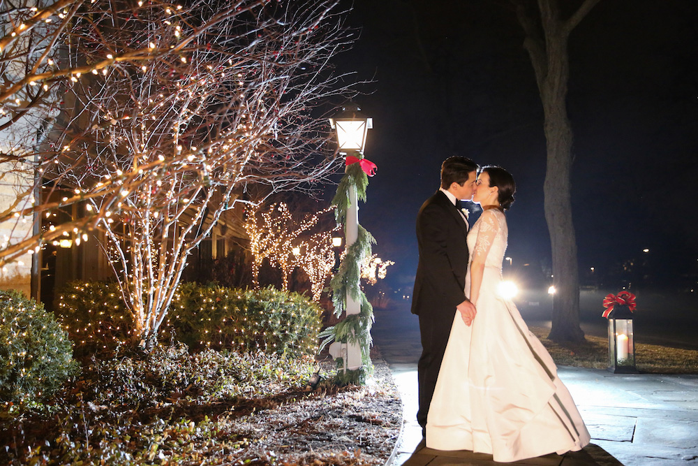 Wedding portrait in snow with Christmas decorations