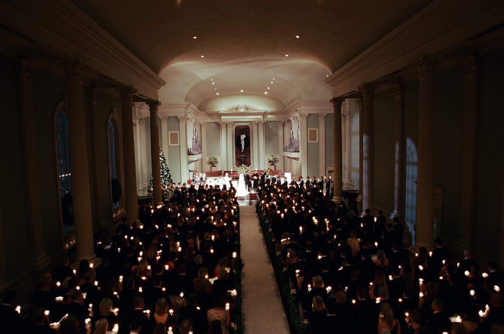Candlelight ceremony at winter wedding