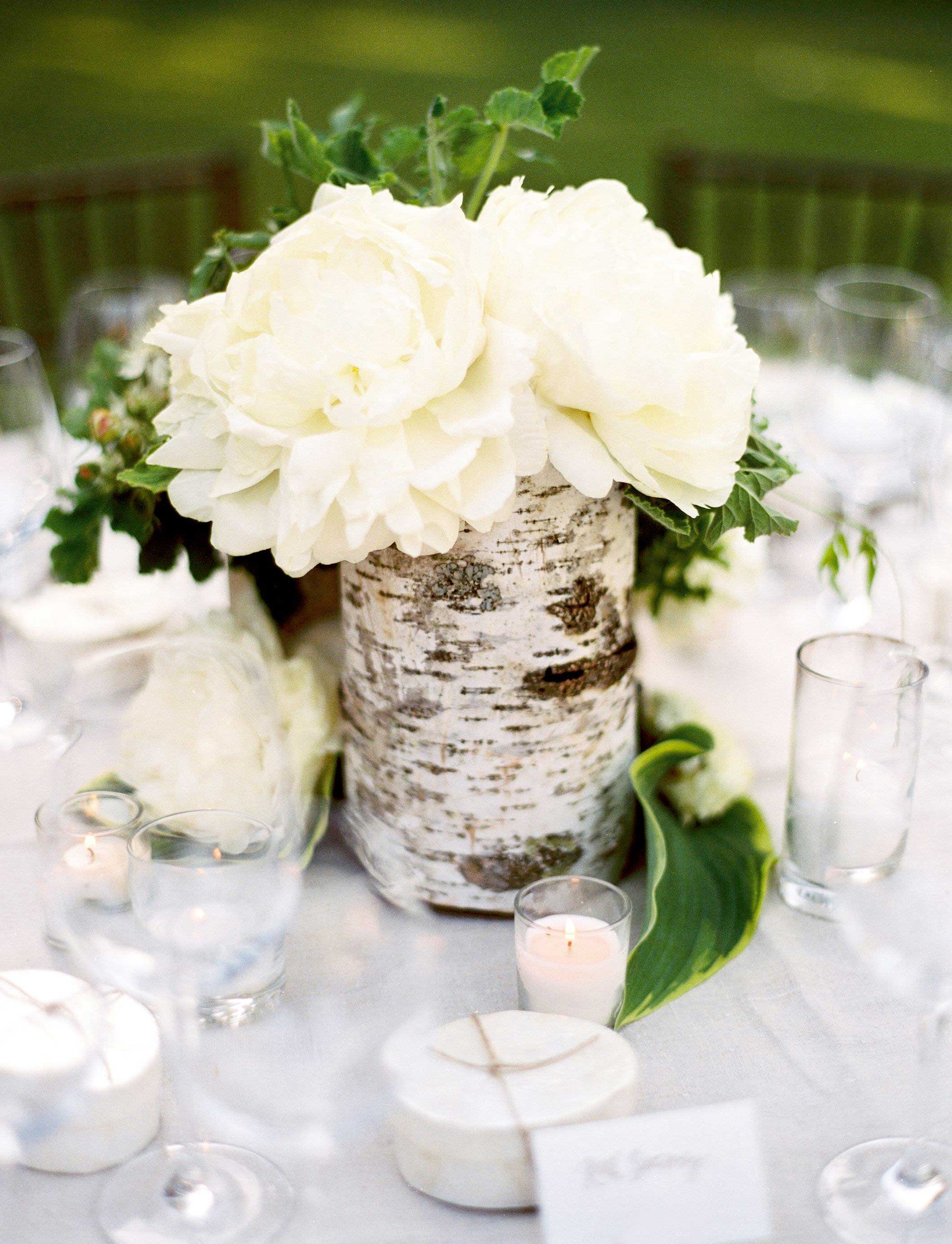 Birch tree bark wrapped around low centerpiece