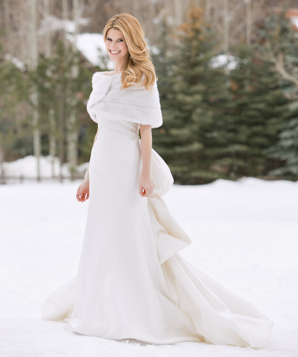 Bride in white wedding dress with fur shawl