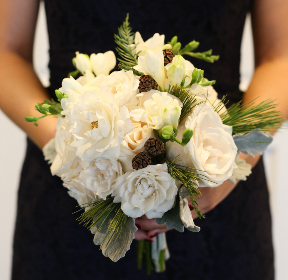 White wedding bouquet with pinecones
