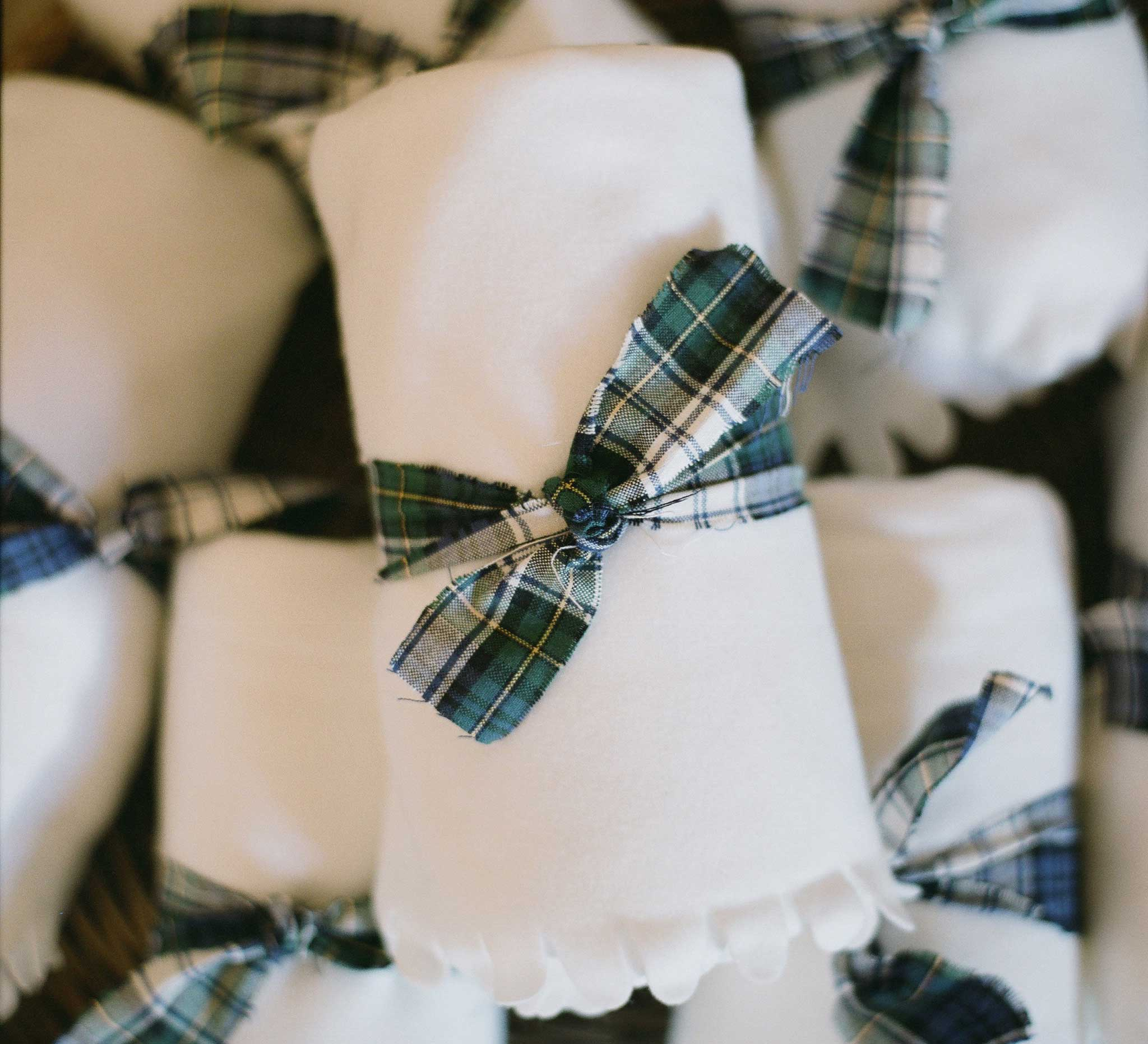 White blanket with plaid bow for wedding