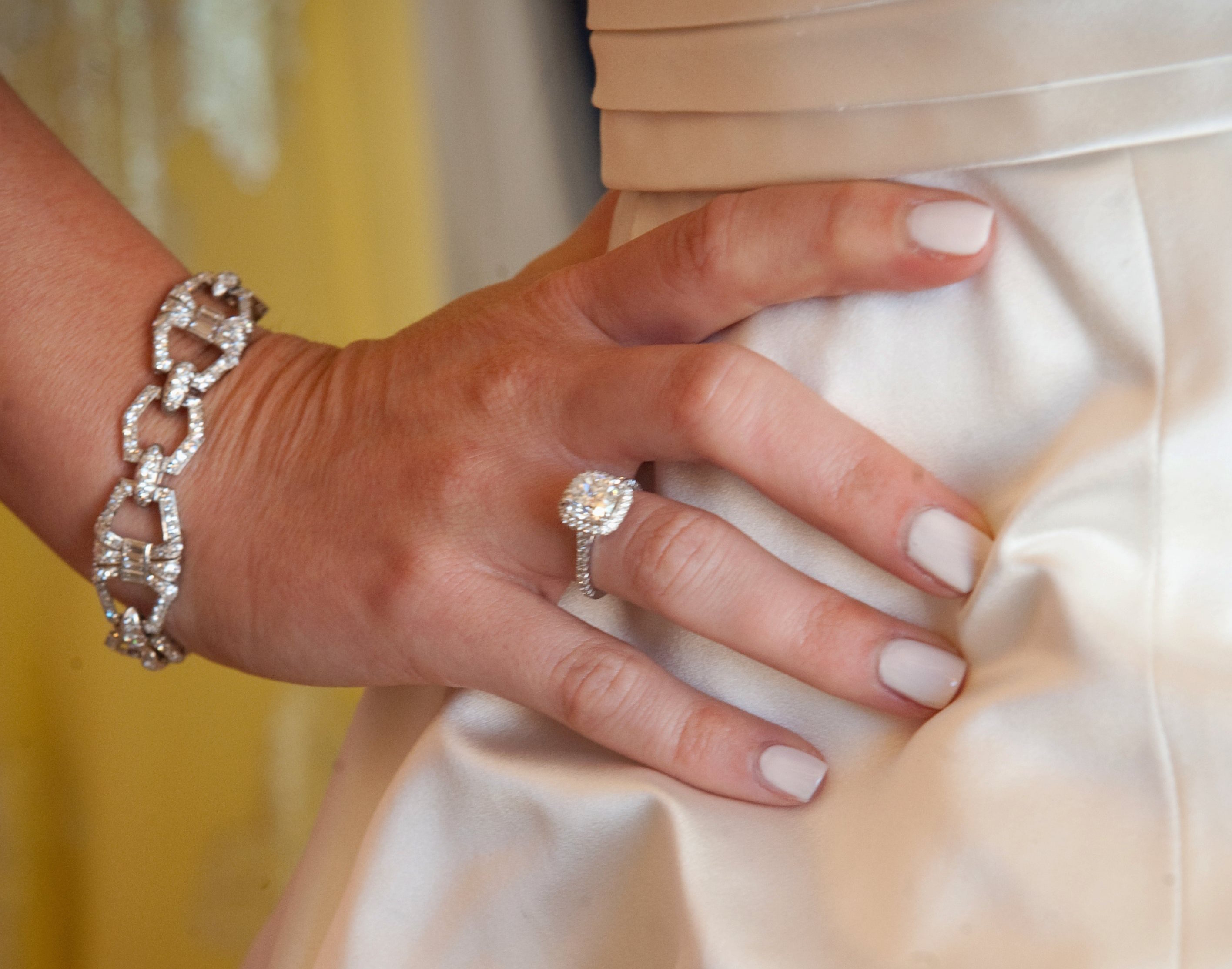 Bride with engagement ring and ivory manicure