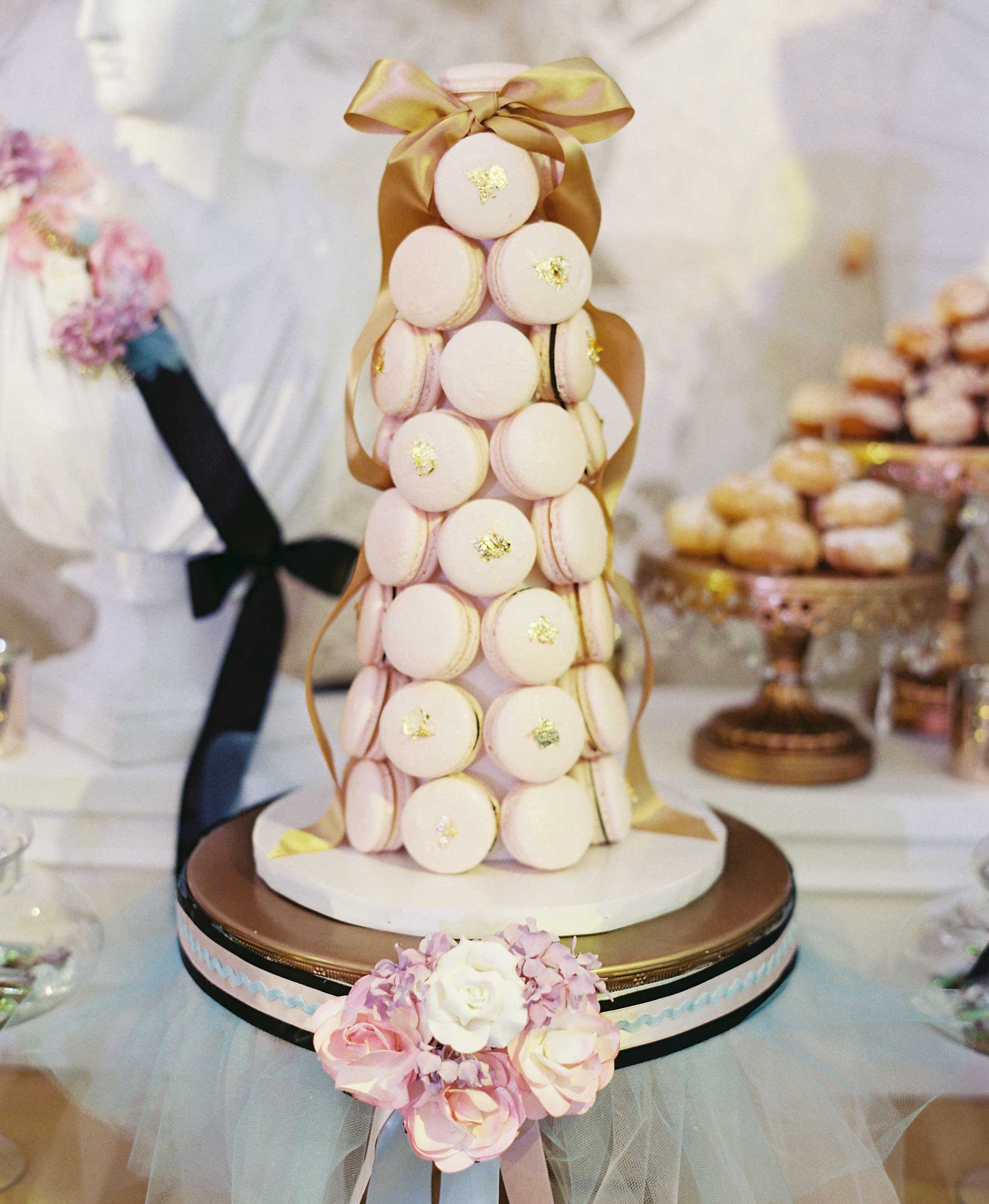 Tower of pink macaron desserts with gold flakes