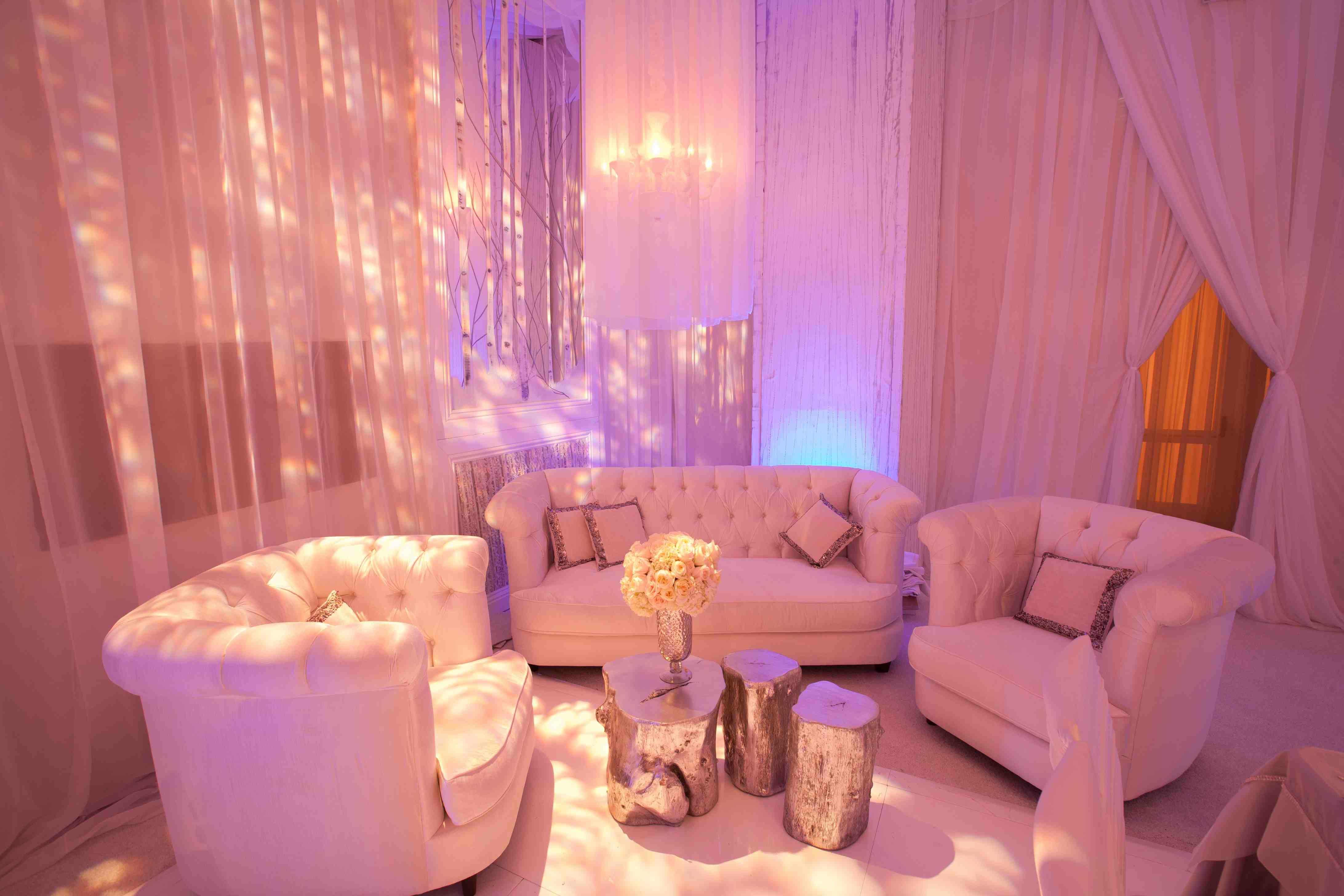 Wedding lounge area with pink lighting