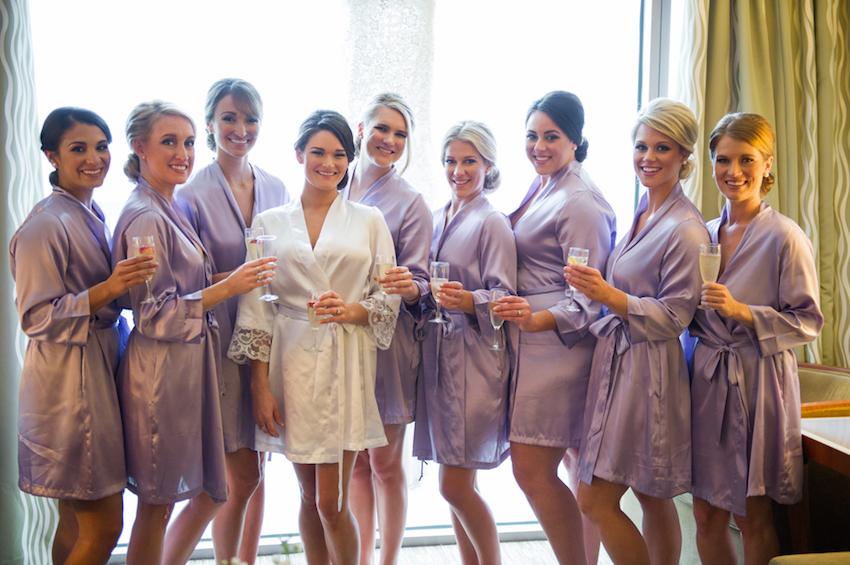 Bridesmaids in silk purple robes