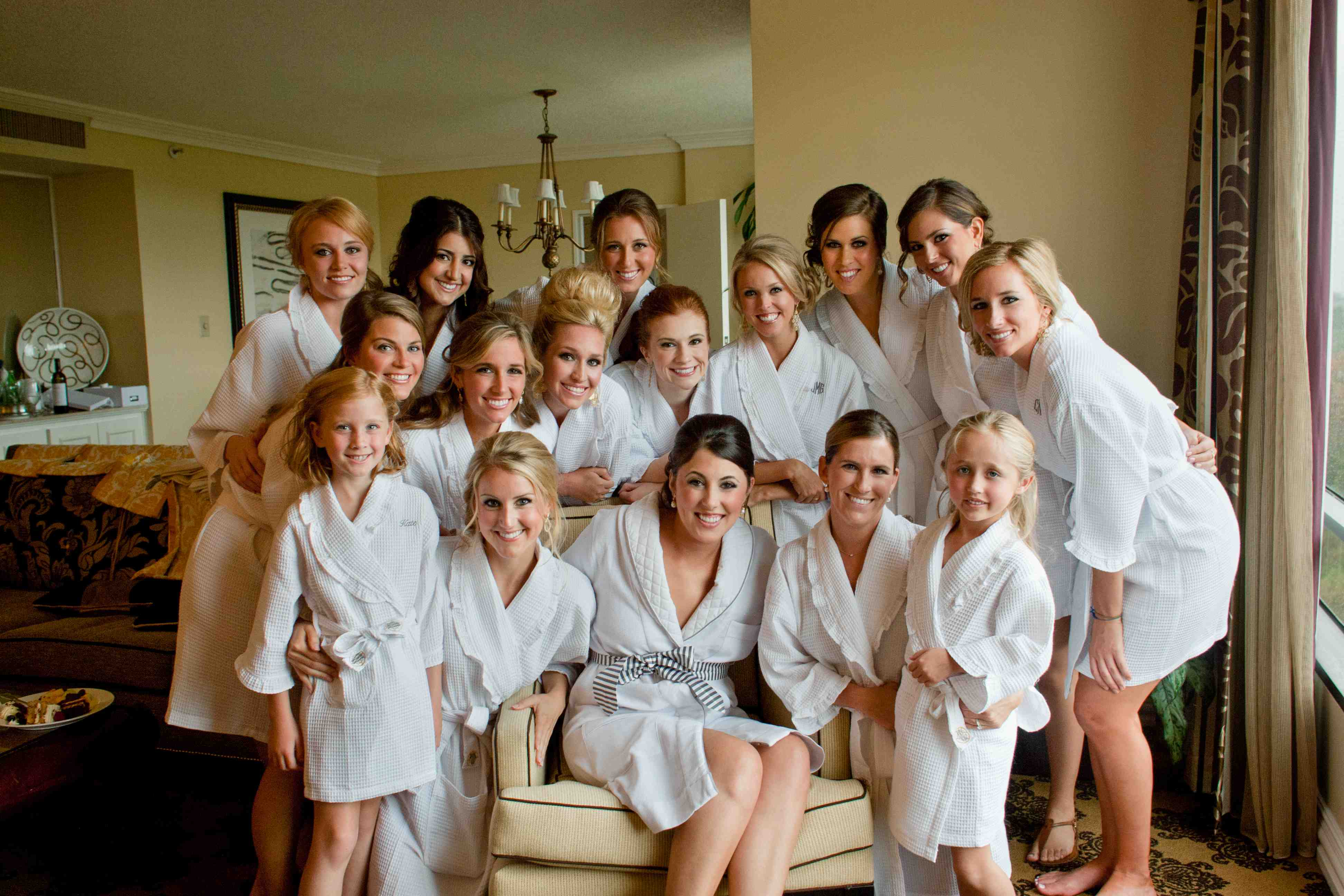 Bride and bridesmaids getting ready photos in white robes