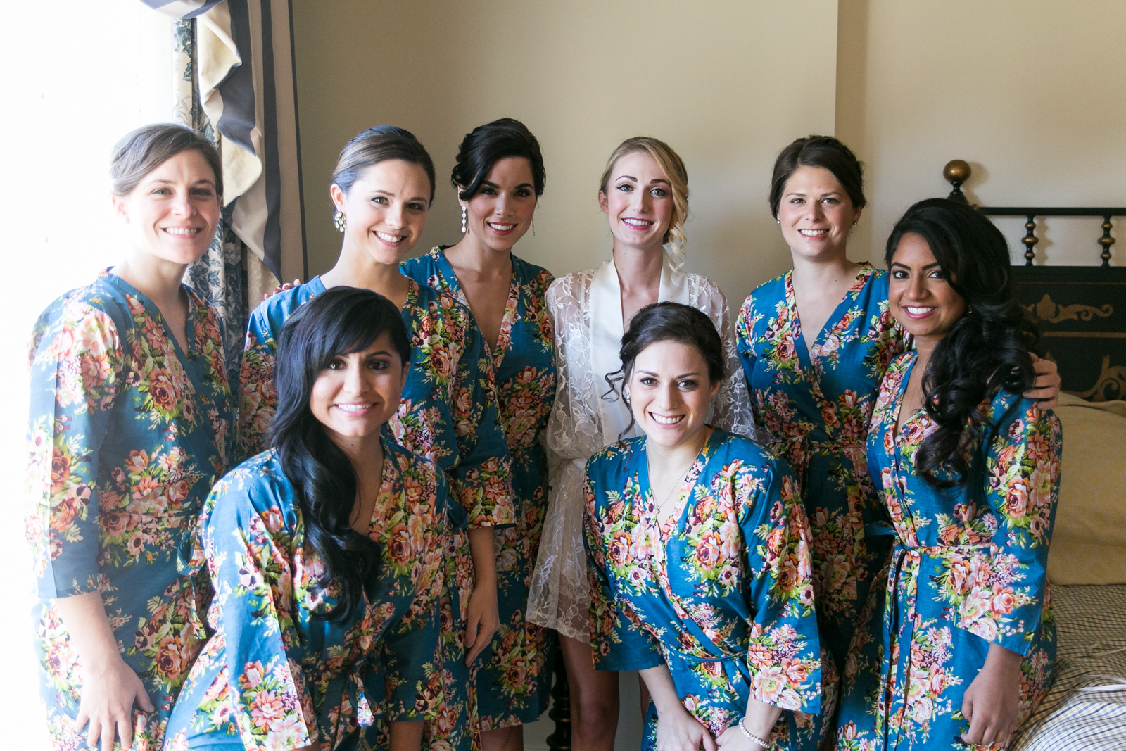 Bridesmaids getting ready photos in blue robes