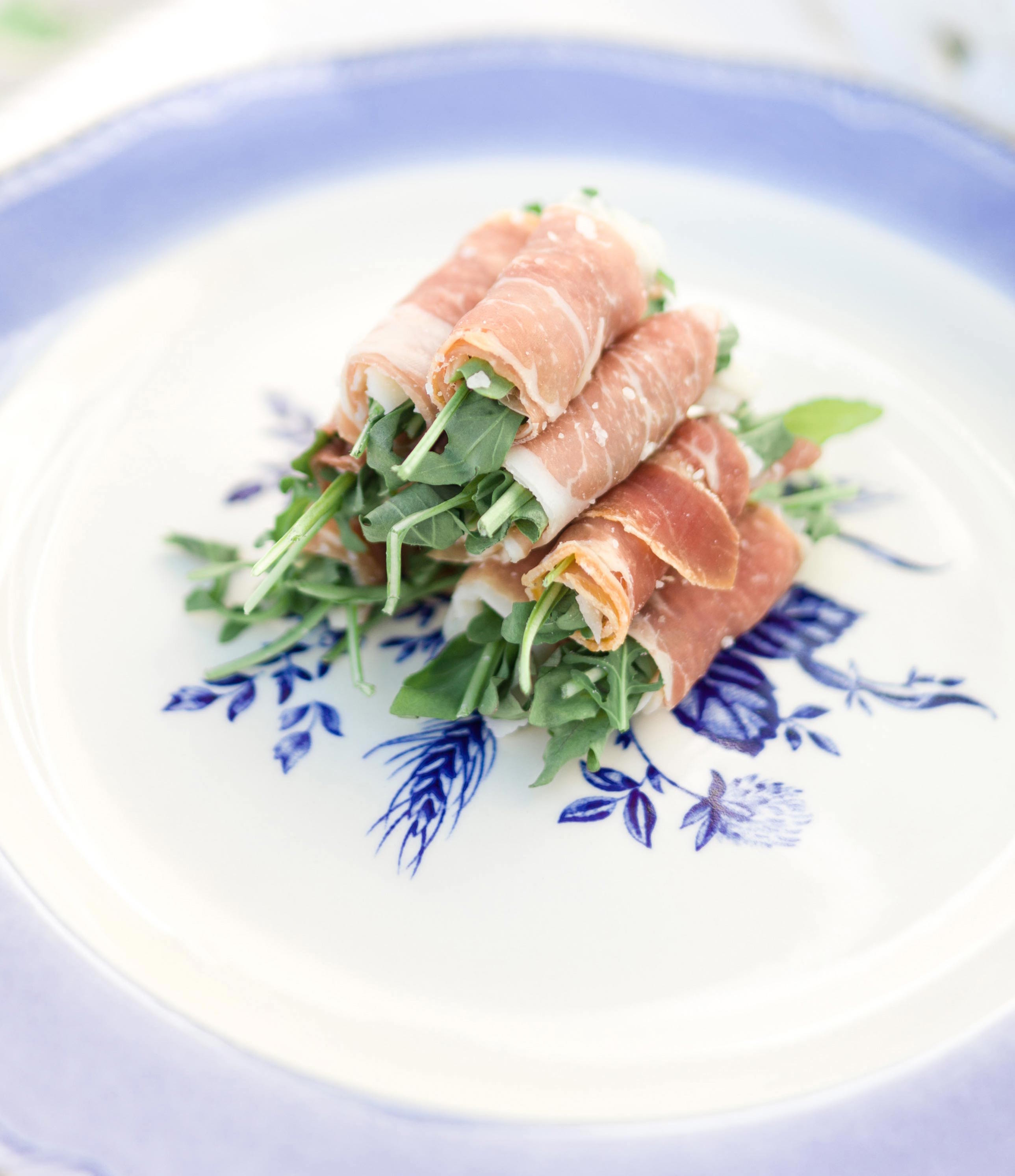 Arugla wrapped with prosciutto appetizer