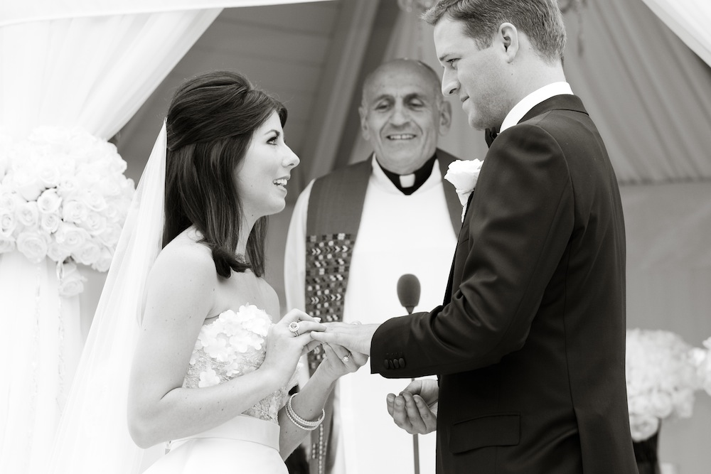 The pros and cons of writing your wedding vows together inside black and white photo of bride and grooms wedding vows junglespirit