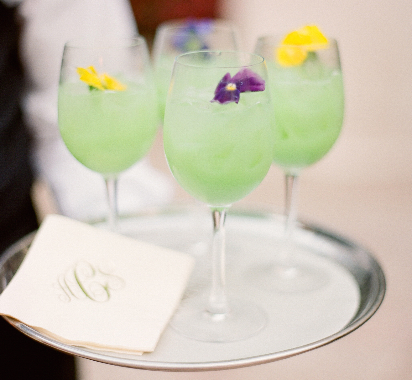 Fresh flowers in light green wedding drink