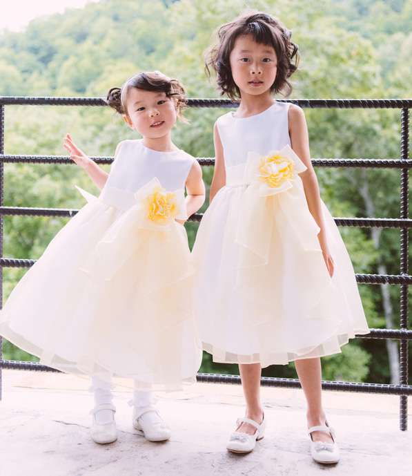 Asian American flower girls in yellow dresses