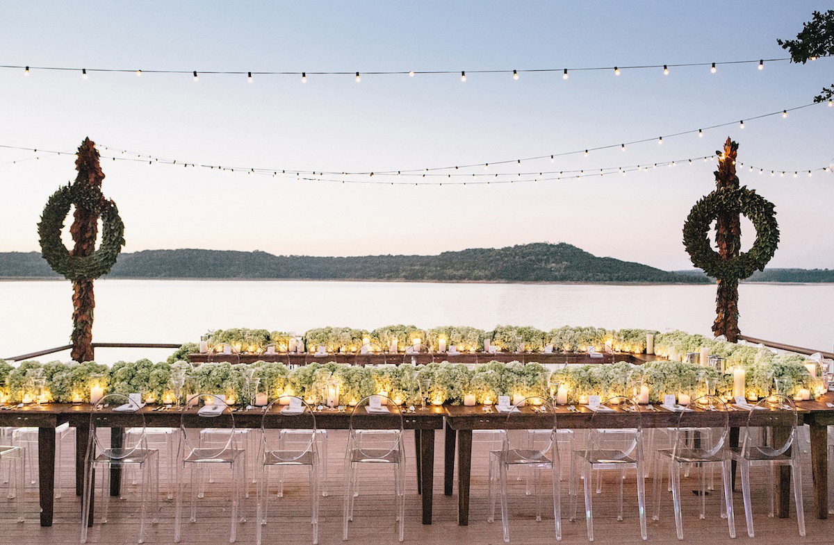 Southern rustic wedding on lake with string lights