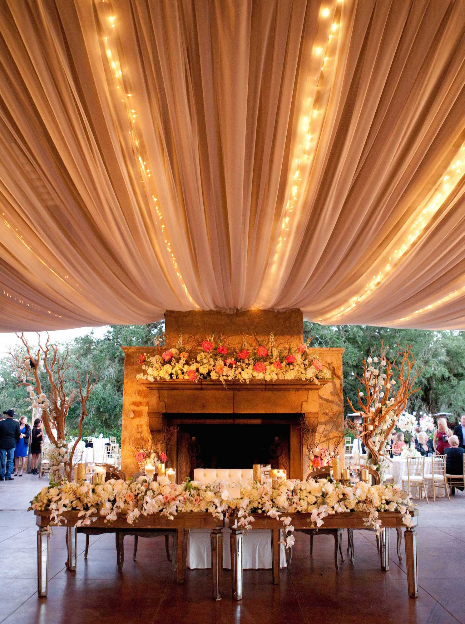 String lights above sweetheart table at wedding