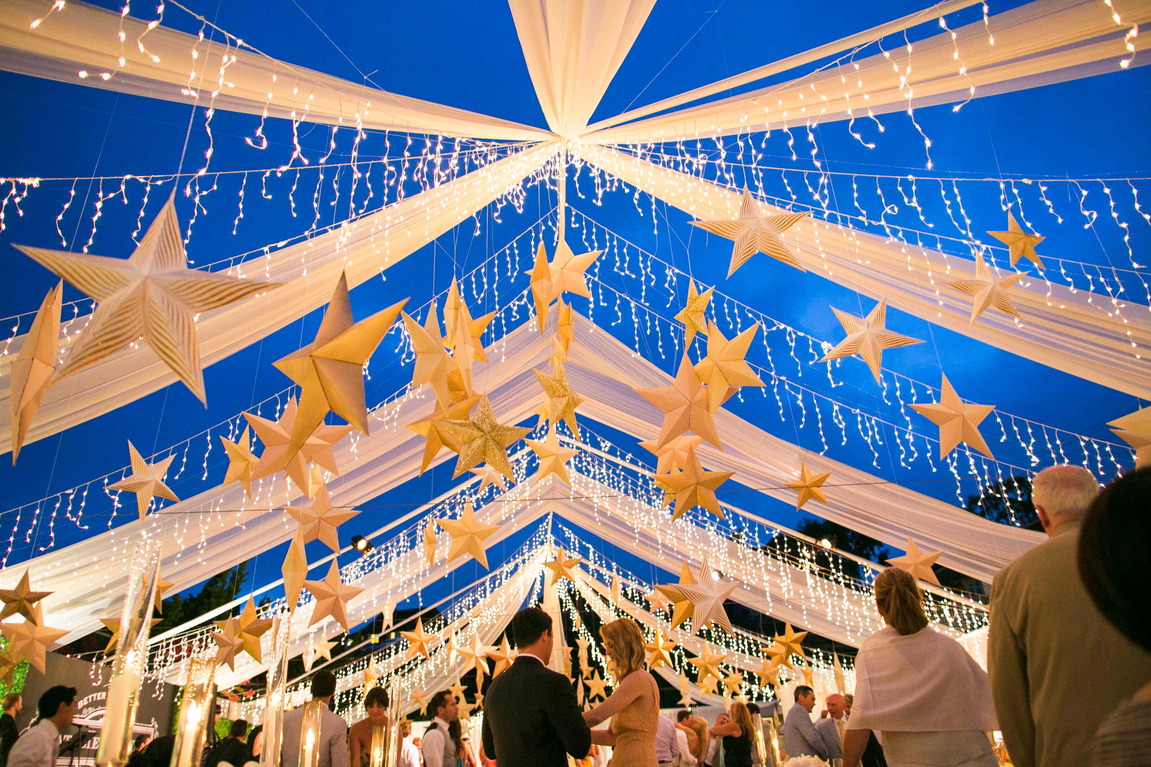 String lights and star lanterns at wedding reception