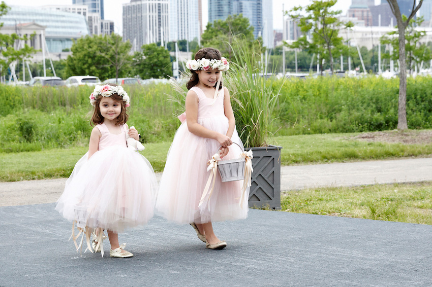 Flower girls in pink dresses and flower crowns