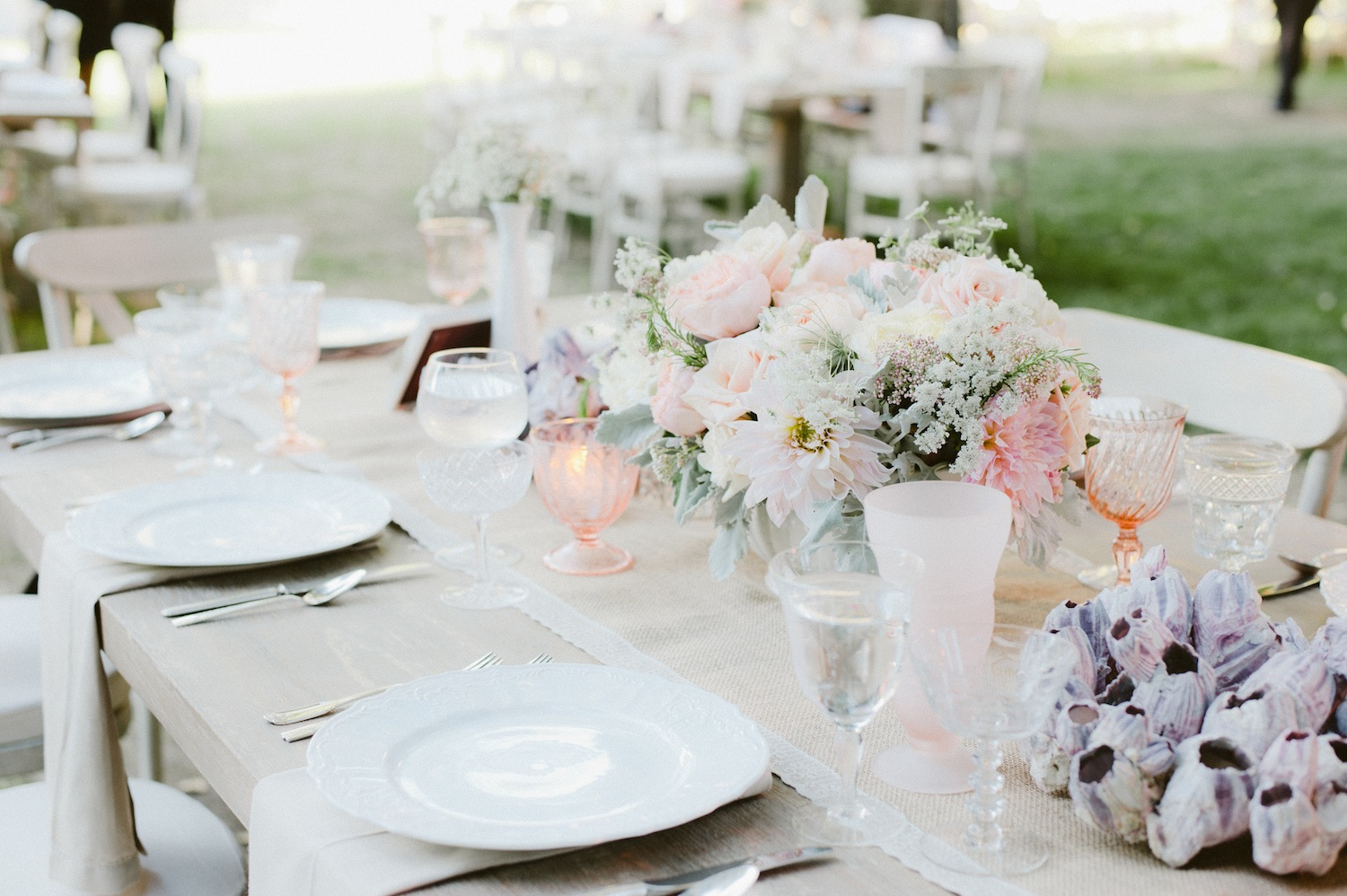 Light pink antique glassware at wedding reception
