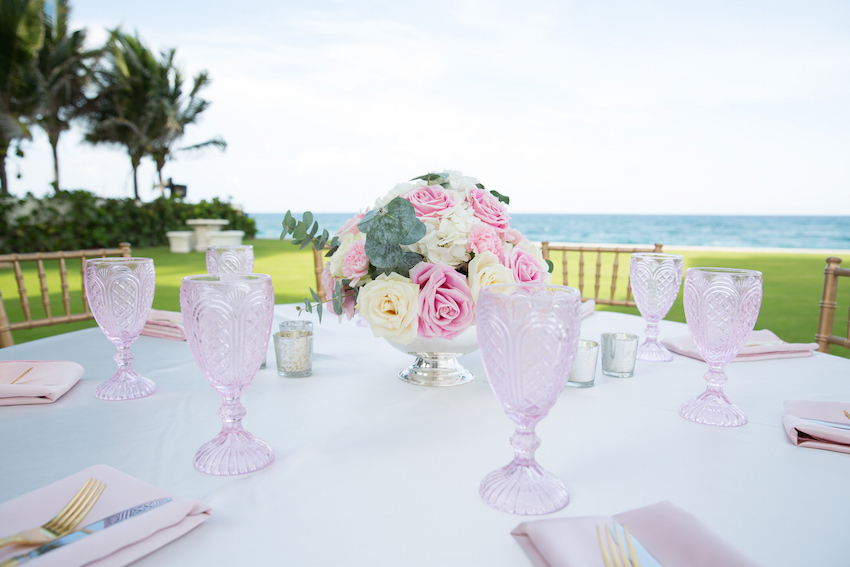 Pink glasses at oceanfront engagement party