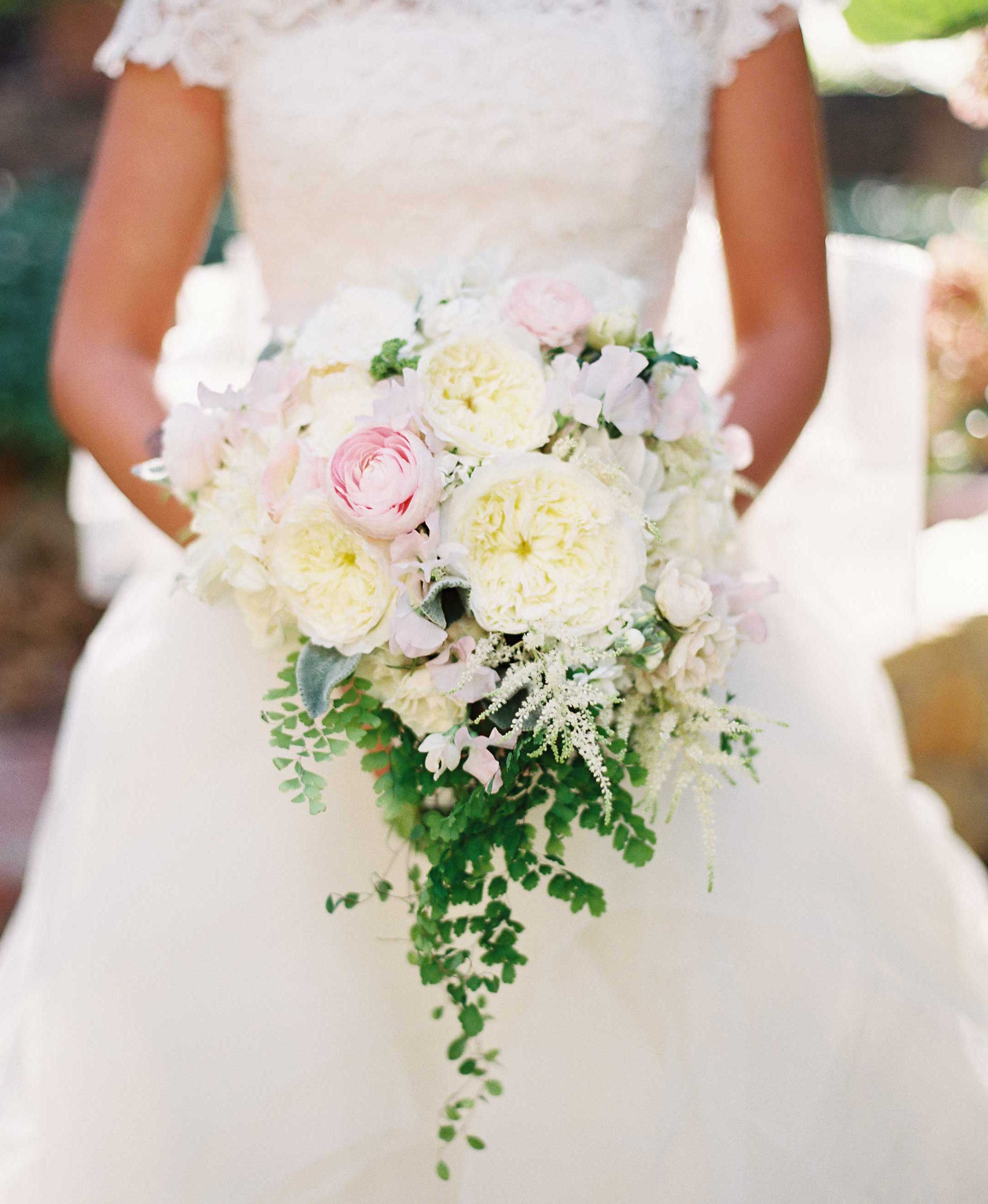 Cascading greenery from white and pink bouquet