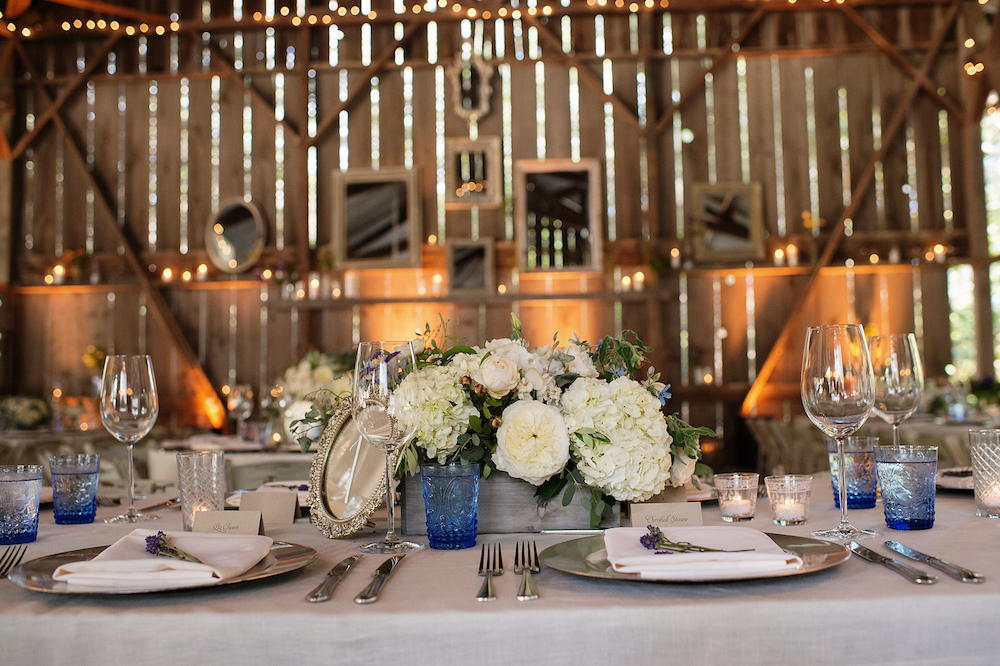 Light blue water glasses at rustic wedding