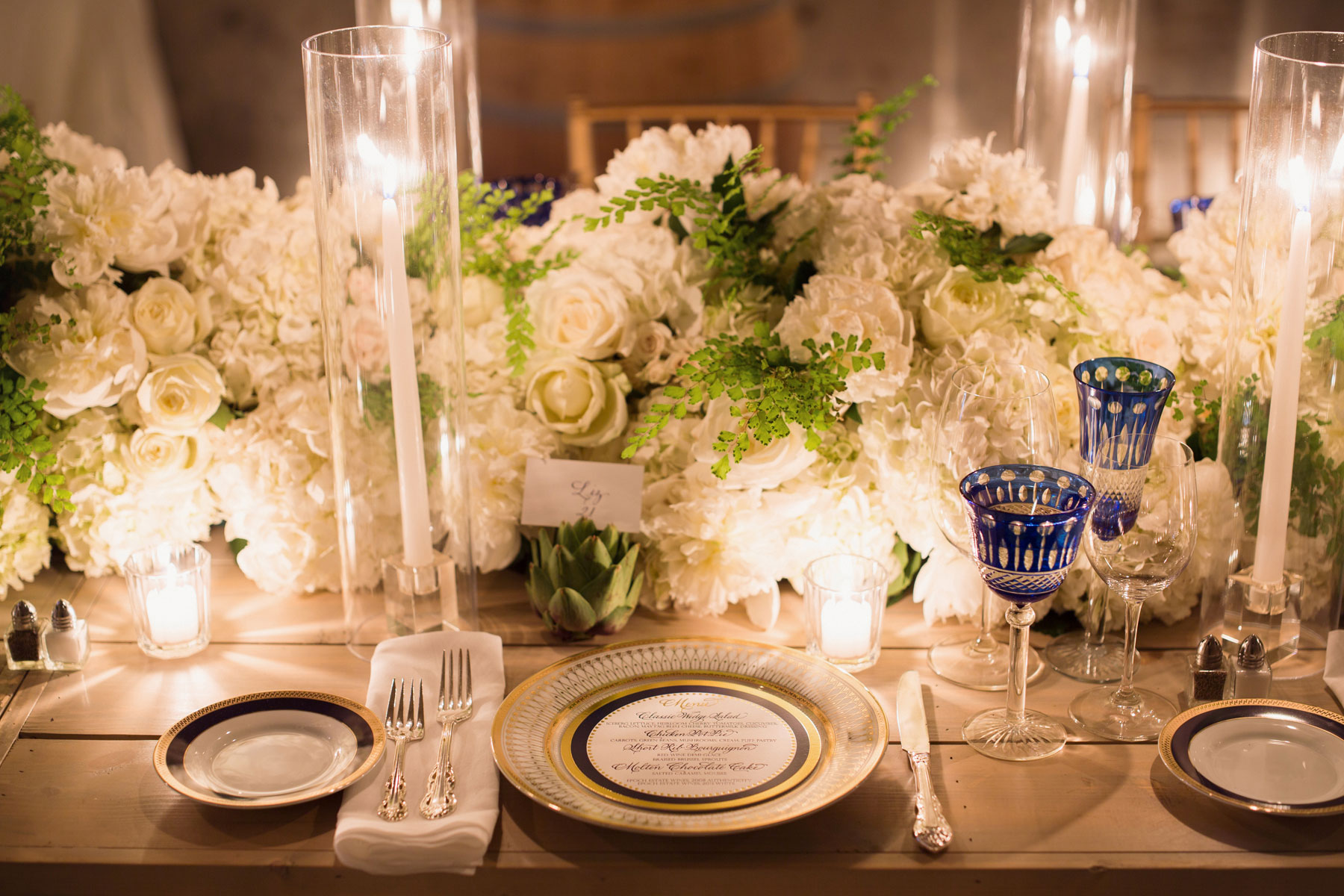 Blue geometric glassware at wedding reception