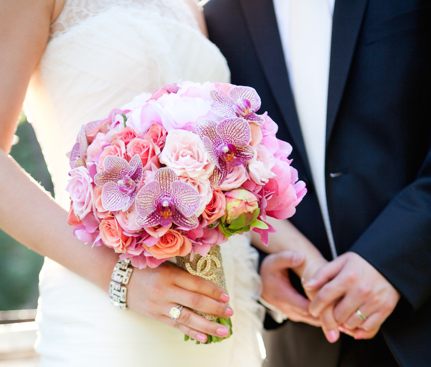 Vibrant round bouquet with pink orchids
