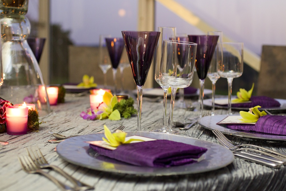 Purple champagne flute glassware at wedding