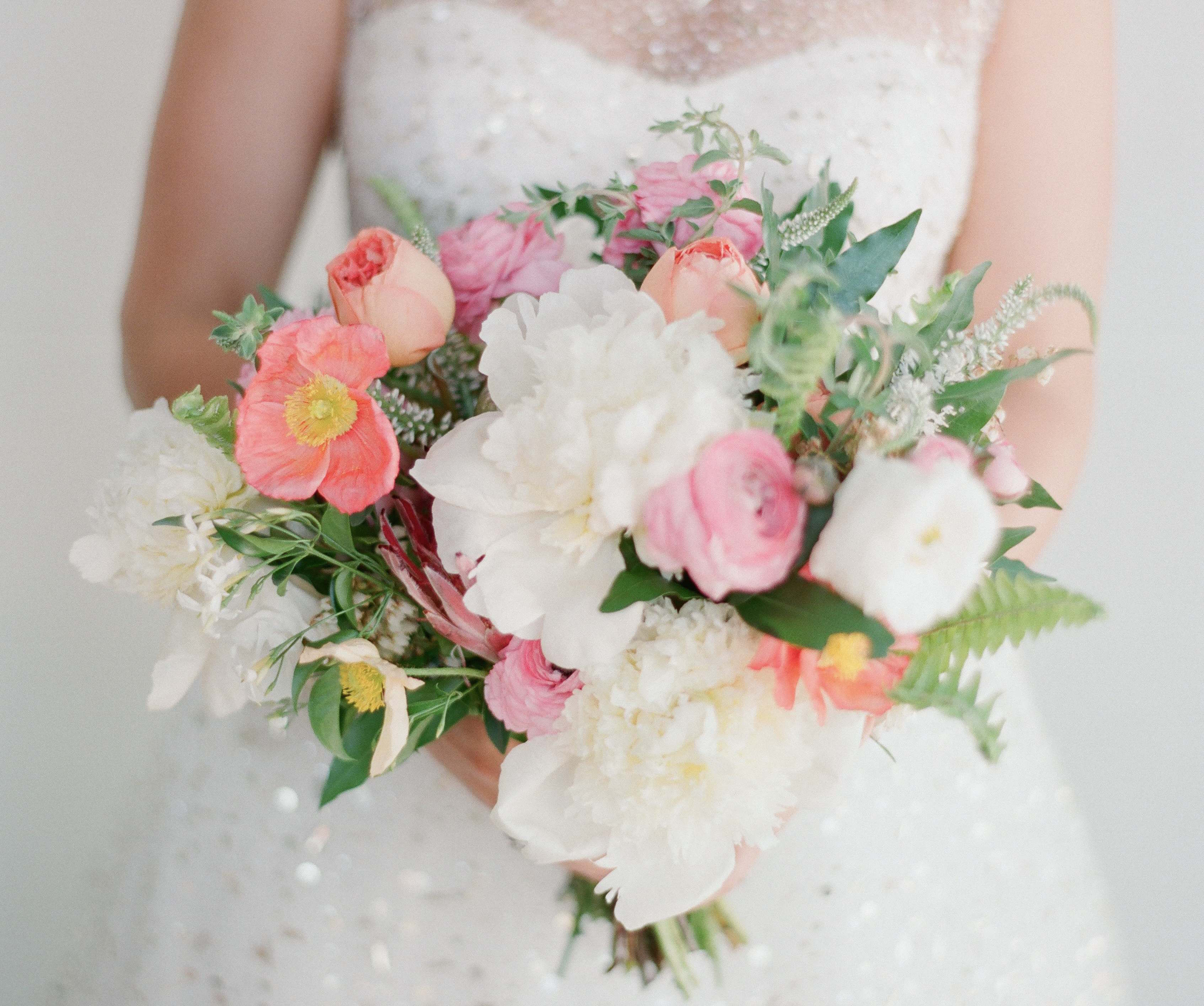 Organic wedding bouquet with pink accents
