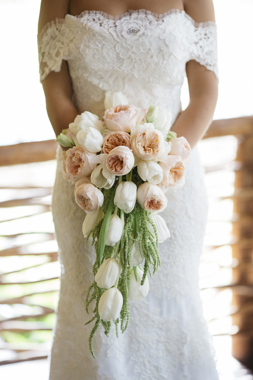 Cascading white tulip and pink garden rose bouquet