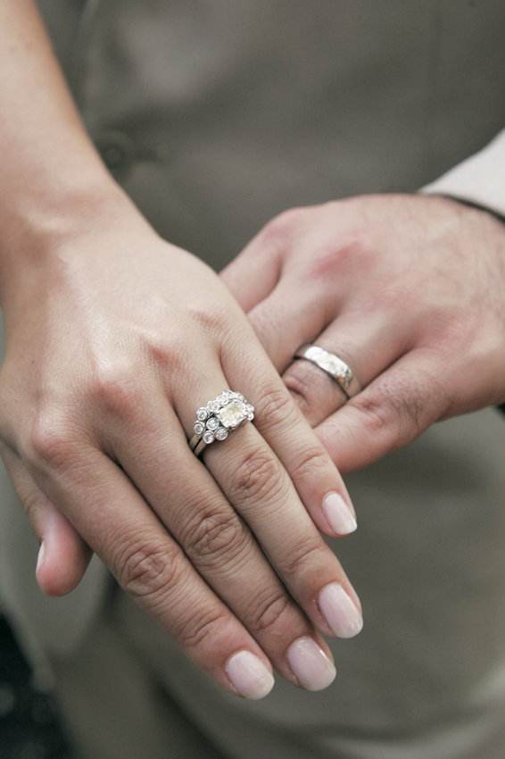 held both bands hand photo rings groom together grooms and showing on wedding engagement bride day their stock