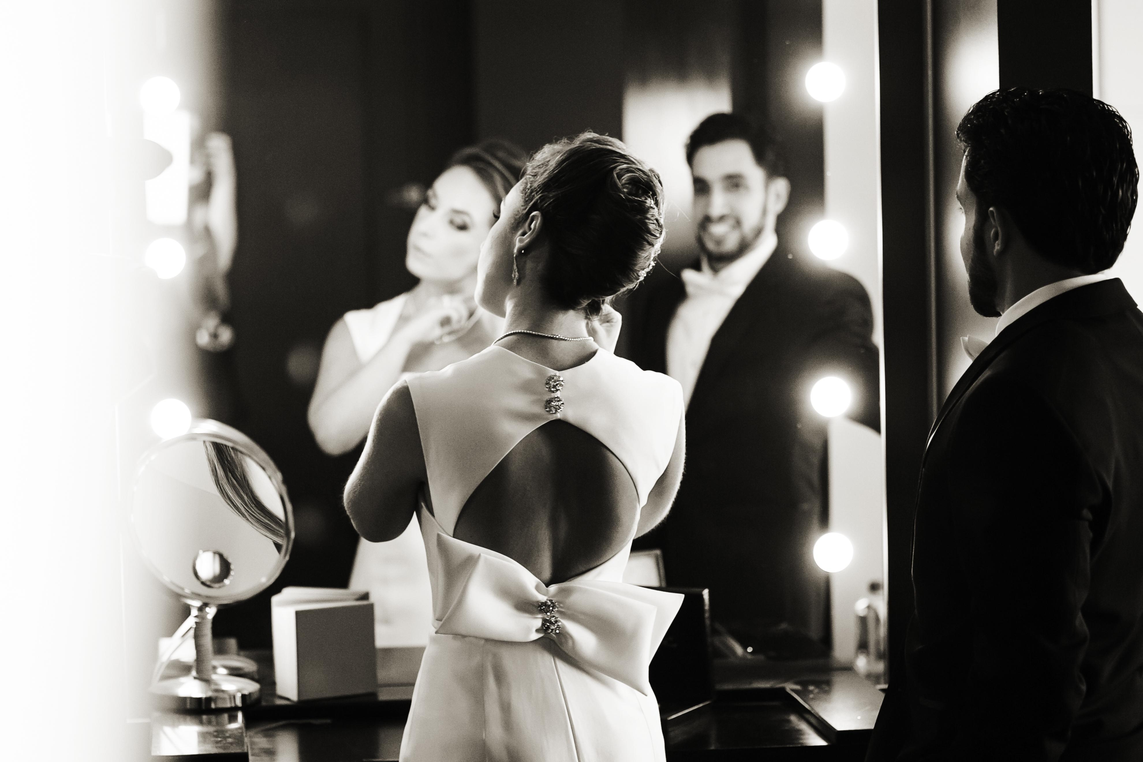 bride wearing silk smale gown with keyhole back and bow embellishment