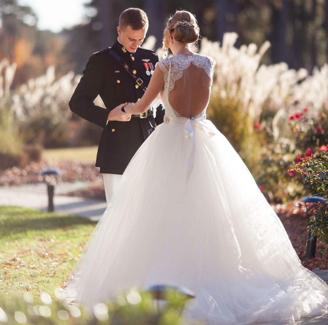 military groom and bride with monique lhuillier sheath lace dress with keyhole back and a tulle overskirt