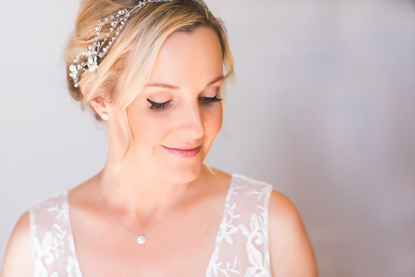 bride with dewey makeup and black eyeliner
