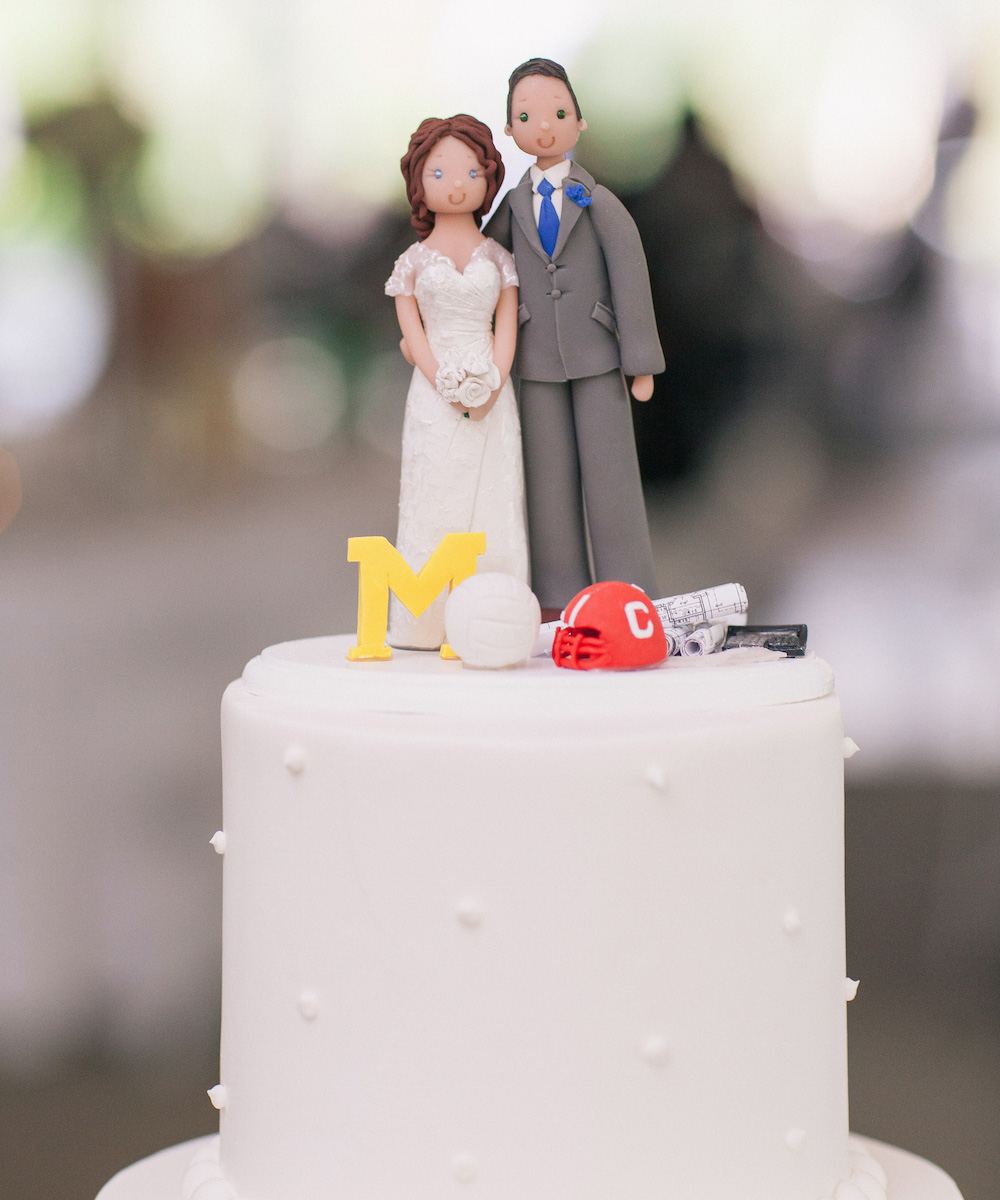 bride and groom cake topper with personalized details