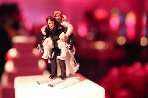 wedding cake topper of bride and groom skiing