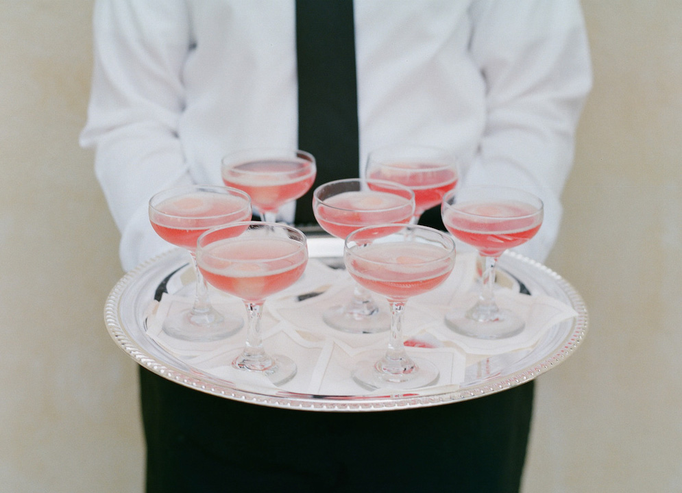 Pink signature cocktails in coupe champagne glasses
