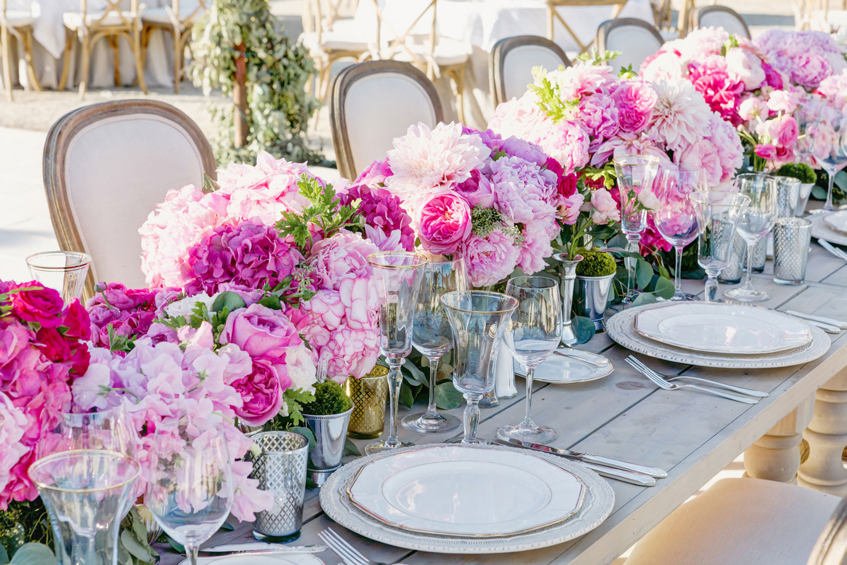 Pink flower table runner at outdoor wedding