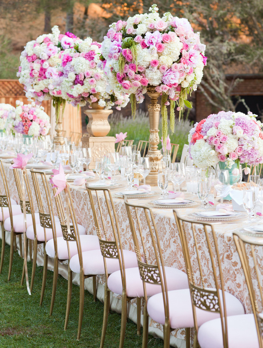 Pink and gold wedding reception chairs