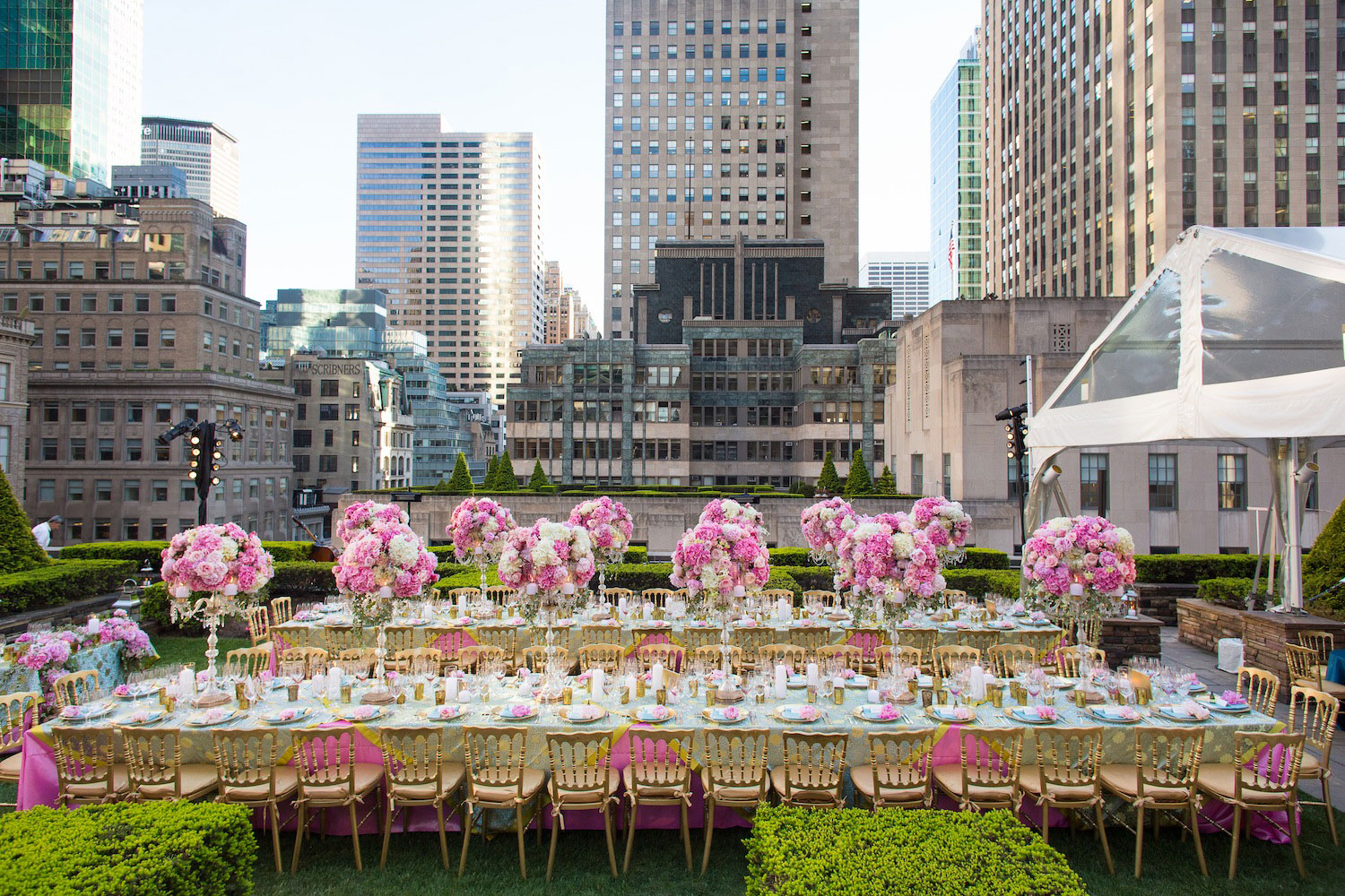 New York City rooftop reception with pink flowers