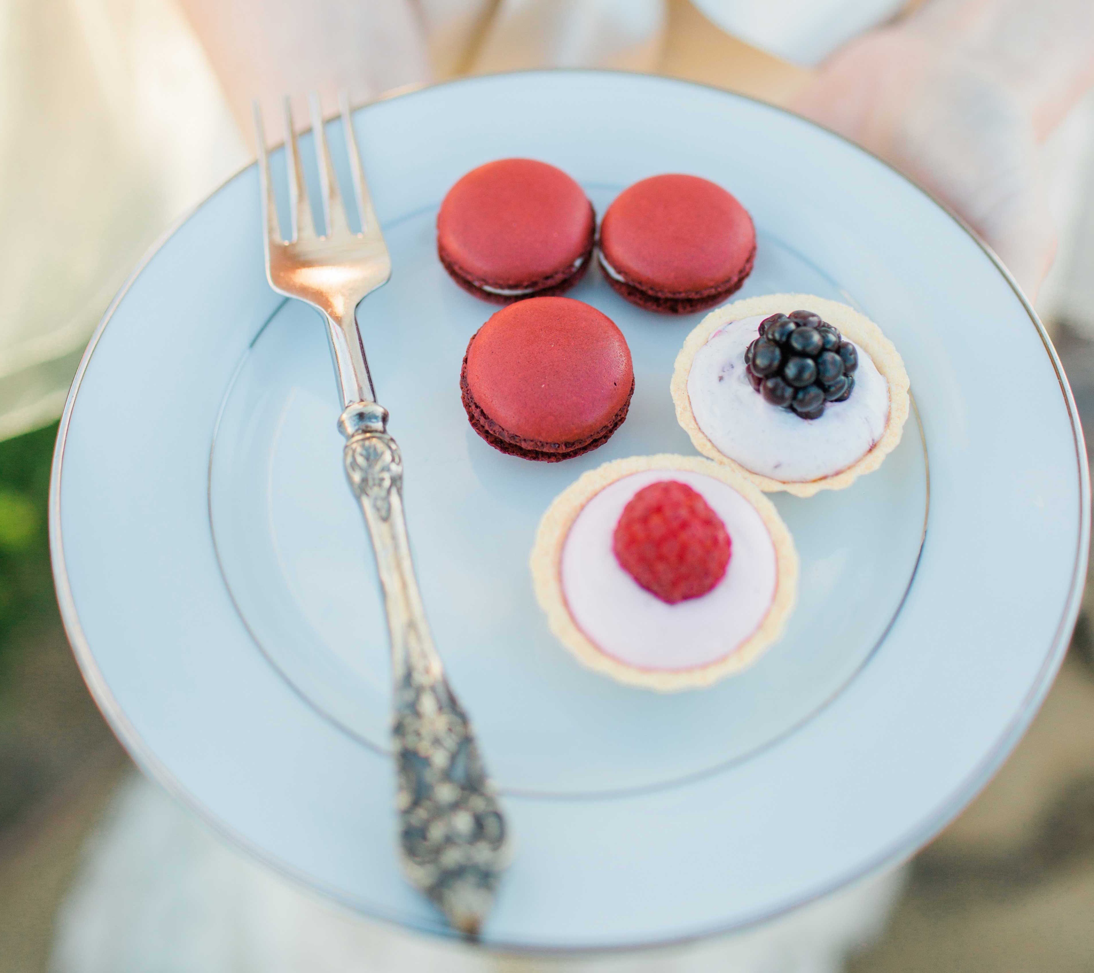 Red French macaron cookies and fruit tarts