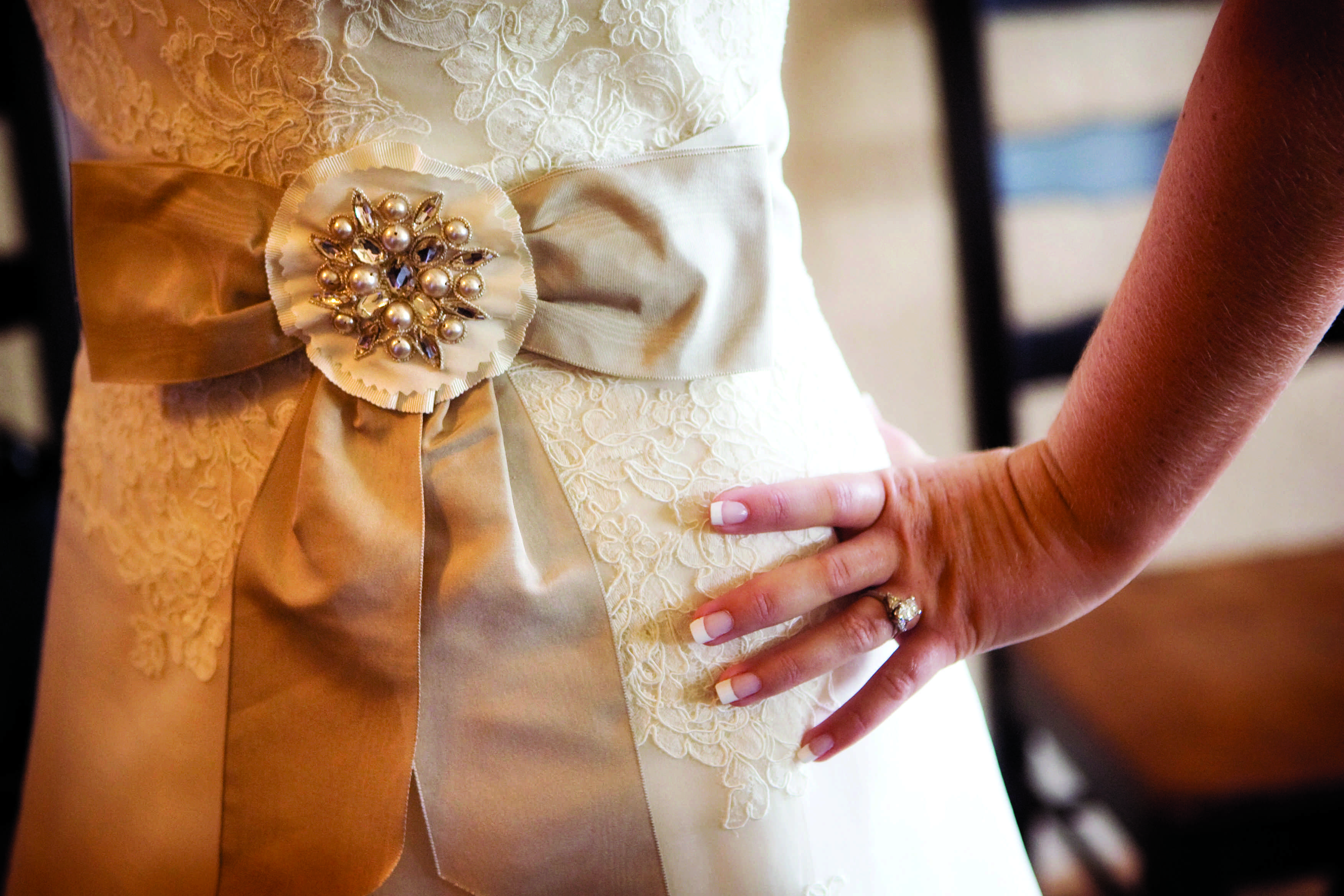 taupe sash with pearl and crystal embellishment on wedding gown