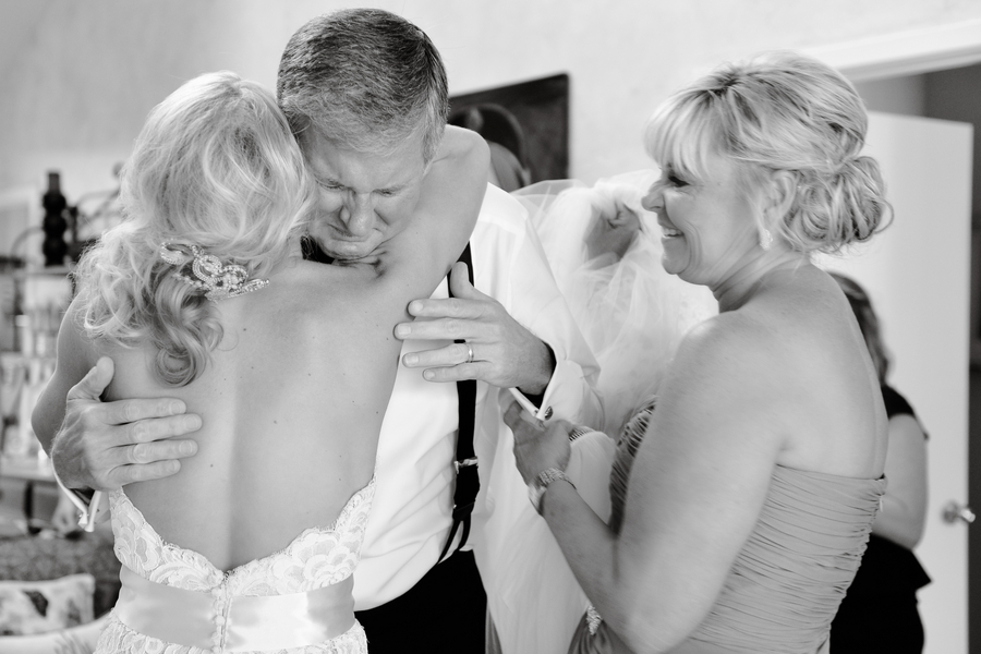 Black and white photo of emotional father of bride
