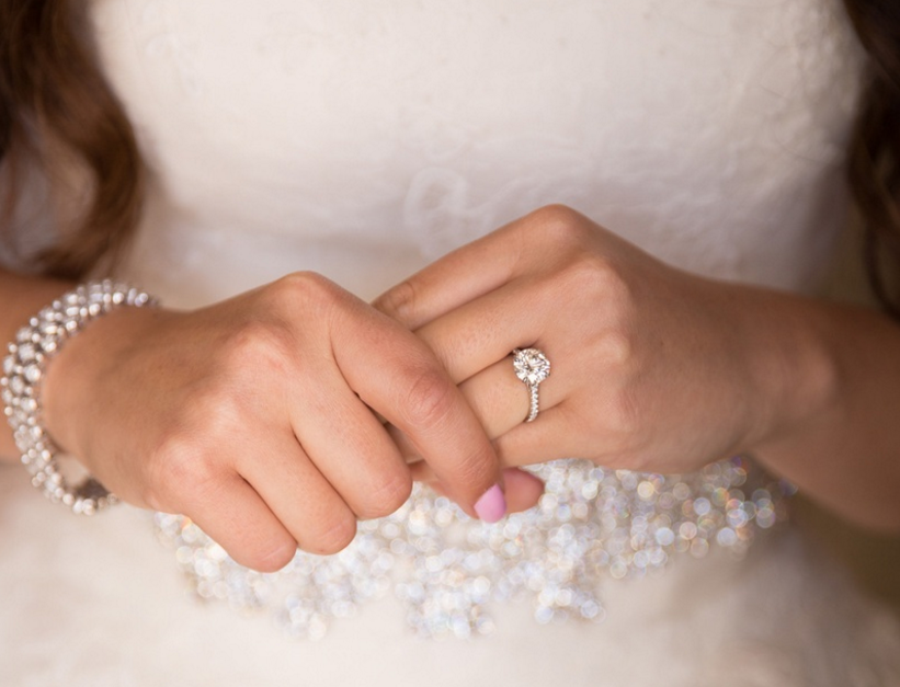 bride with solitaire diamond engagement ring