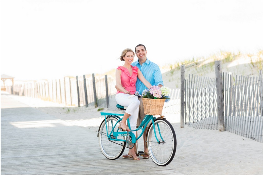beach engagement shoot couple on bike