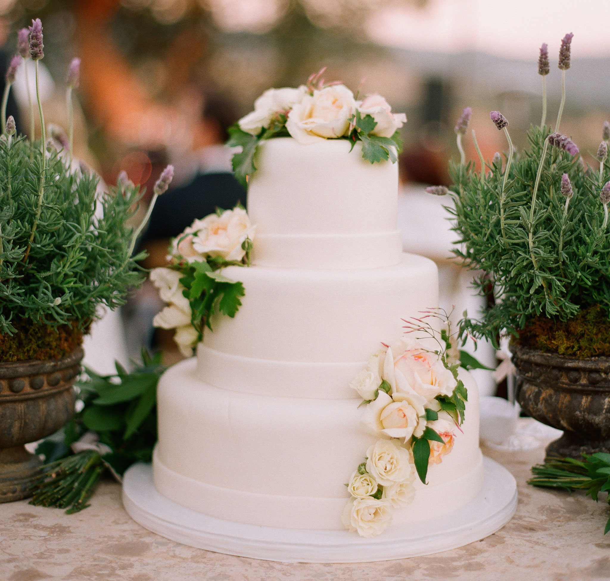 White wedding cake with fresh flowers