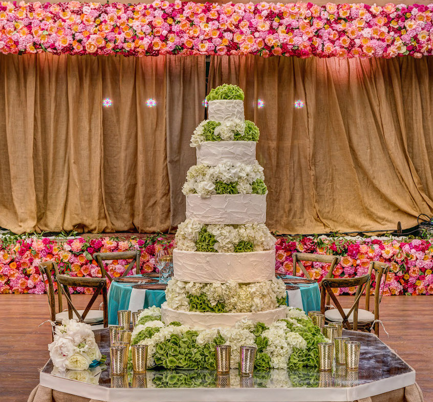White wedding cake with white and green hydrangea layers
