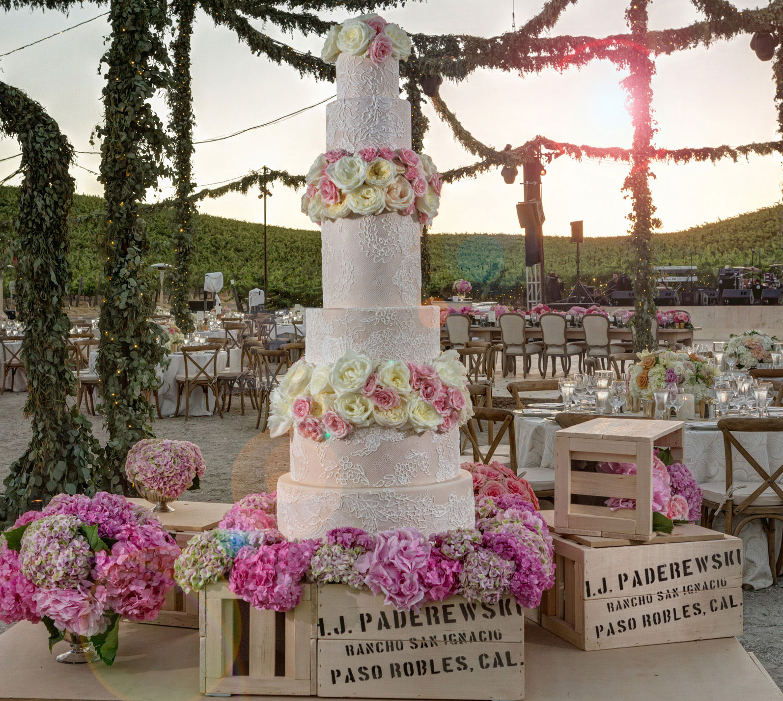 Pink wedding cake with fresh flower decorations