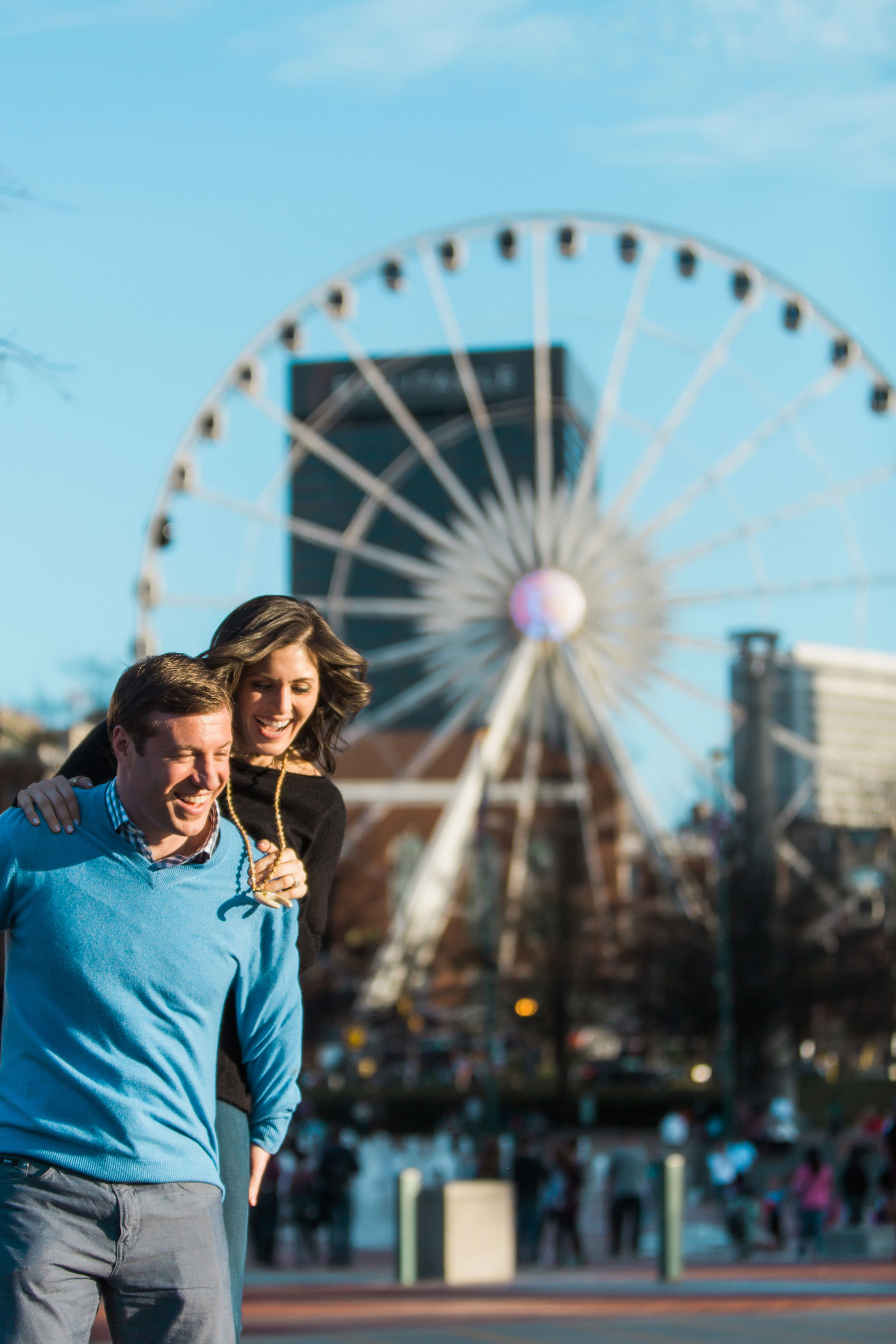 Atlanta e-session bride and groom in front of ferris wheel Vue Photography engagement session
